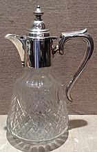 AN EDWARDIAN HALLMARKED SILVER AND CUT GLASS CLARET JUG The body mount