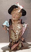 A LATE 19TH CENTURY GERMAN POTTERY BUST Of a dandy gentleman in 18th C