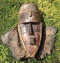 A CARVED AFRICAN TRIBAL ART SONGYE WOODEN MASK Having carved eyebrows