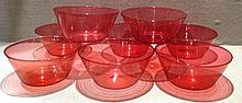 A SET OF EIGHT EARLY 20TH CENTURY CRANBERRY GLASS BOWLS Of conical sha