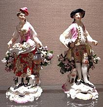 A PAIR OF 18TH CENTURY DERBY PORCELAIN FIGURES Of a farming couple in