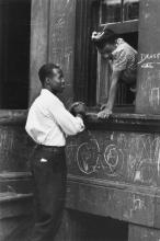LEVITT, HELEN (1913-2009) Greeting at the window, New York City.