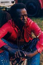 MARSHALL, JIM (1936-2010) Miles Davis (1970) * John Coltrane (1963) * Thelonius Monk (1963). Together, 3 photographs.