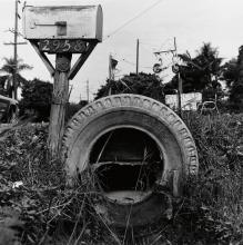 RAUSCHENBERG, ROBERT (1925-2008) Study of a mailbox and tire.