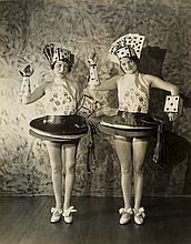 (FLAPPER VERNACULAR) Pair of flapper-era women dressed in poker outfits, with headwear featuring a full house and a straight.