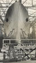 (BATTLESHIPS & AVIATION) Album with nearly 175 photographs of ships, many in various stages of contruction and launch