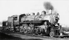 (LOCOMOTIVES) Pair of albums with more than 325 snapshots of trains from all angles and in all types of weather,