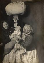 HINE, LEWIS W. (1874-1940) Three women and a baby at Ellis Island.