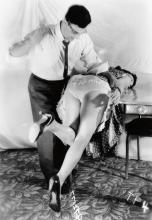 (EROTICA) Group of 13 over-the-knee spanking photographs depicting an American couple in their living room.