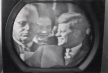 (KENNEDY, JOHN F.) Mini-album with 14 snapshots made of a television screen depicting Kennedy's presidential inauguration.