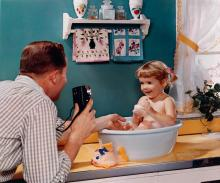 (ADVERTISING) A charming advertisement for cameras, with a little girl in a soapy bath who is