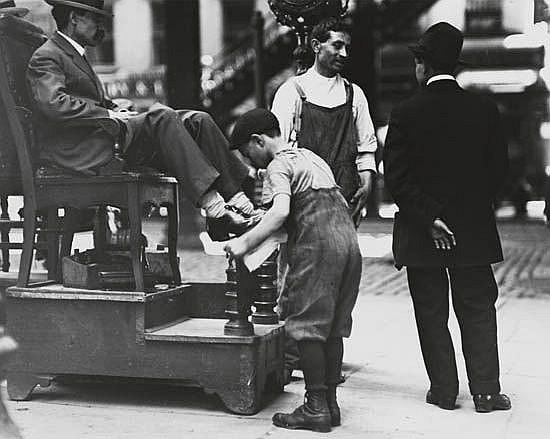 HINE, LEWIS W. (1874-1940) Shoe shine boy working.
