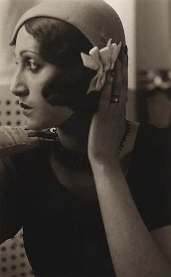 LARTIGUE, JACQUES HENRI (1894-1986) Renée Perle with hand on hat.
