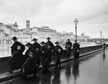 ALFRED EISENSTAEDT (1898-1995) Monks along the River Arno, Florence, Italy.