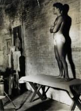 WEEGEE (1899-1968) An artist's male nude model in a studio.