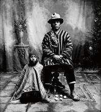 IRVING PENN (1917-2009) Egg Seller with His Son, Cuzco.