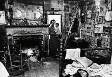 BRUCE DAVIDSON (1933- ) Mrs. Blackman in a cabin holding baby, Trickum Forks, Alabama.