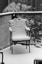 ANDRÉ KERTÉSZ (1894-1985) Snow covered chair.