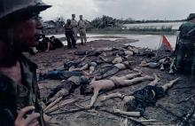 (LARRY BURROWS) (1926-1971) South Vietnamese and American Troops with Viet Cong Prisoners, Mekong Delta, Vietnam.