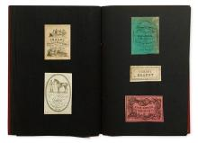 (TRADESMEN'S CARDS.) Album containing approximately 125 cards,