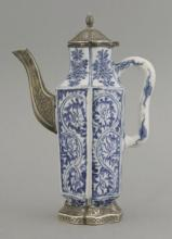 A rare moulded blue and white Ewer