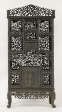 A profusely carved blackwood Display Cabinet