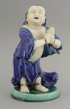 A Chinese biscuit porcelain figure