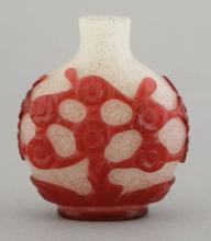 A Peking overlay glass snuff bottle
