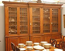 A Victorian oak breakfront bookcase,  the cornice over glazed cupboards, enclosing adjustable sh