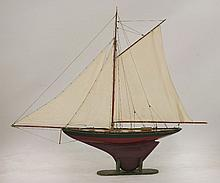A late Victorian model racing yacht,  'Roxanne, Dinard' with three sails, fully re-rigged,
