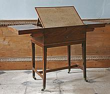 A George III mahogany gentlemanÉs campaign writing table,   c.1815, the folding top revealing a