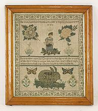 A needlework sampler,   19th century, worked by Anne Rees, with verses, decorated with a girl an