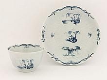 A rare Worcester blue and white Tea Bowl and Saucer,  c.1755-1770, embossed with strap flutes an
