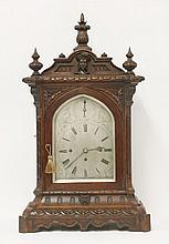 A good Victorian oak mantel clock,  the carved case housing a three train musical movement, stri