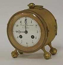 A gilt drum table clock,  the painted enamel dial inscribed 'Brandt, Jeanrenaud et Robert', with