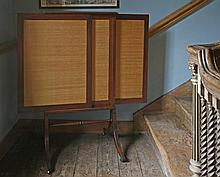 A Georgian mahogany fire screen,  c.1810, with sliding panels issuing from the centre over a tur