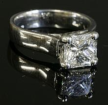 A platinum single stone diamond ring, with a princess cut diamond, estimated as 2.22ct, four claw ...