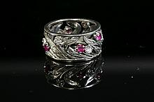 A synthetic ruby and diamond floral band ring