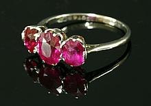 An Art Deco three stone ruby and synthetic ruby ring