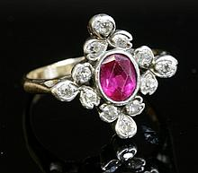 A synthetic ruby and diamond lozenge-shaped cluster ring