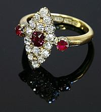 A late Victorian ruby and diamond marquise shaped cluster ring