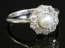 A pearl and diamond circular cluster ring