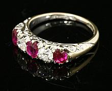 A late Victorian five stone ruby and diamond carved head ring