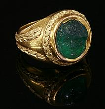 A carved emerald cameo ring