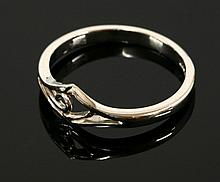 A platinum ring, with an open lozenge shaped head,