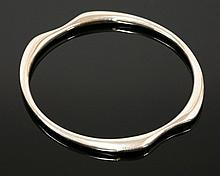A sterling silver bangle by Georg Jensen, No. 155,