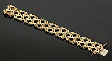 A 9ct gold open lozenge and kiss link bracelet,