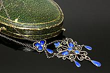 A silver and enamel sølje pendant, by Marius