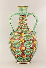 A Della Robbia pottery twin-handled ewer,