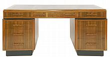 An Art Deco walnut pedestal desk,  the black tooled leather writing sur